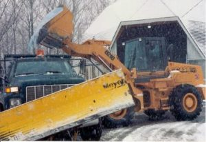 Snow plow being loaded with salt