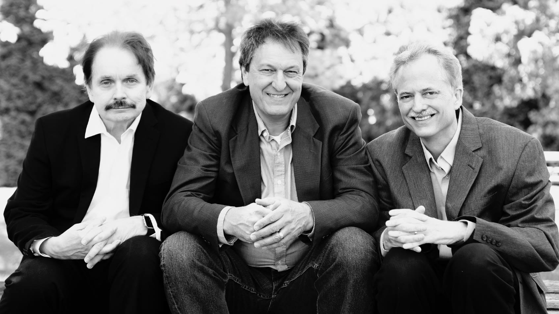 Three members of the band String Theory