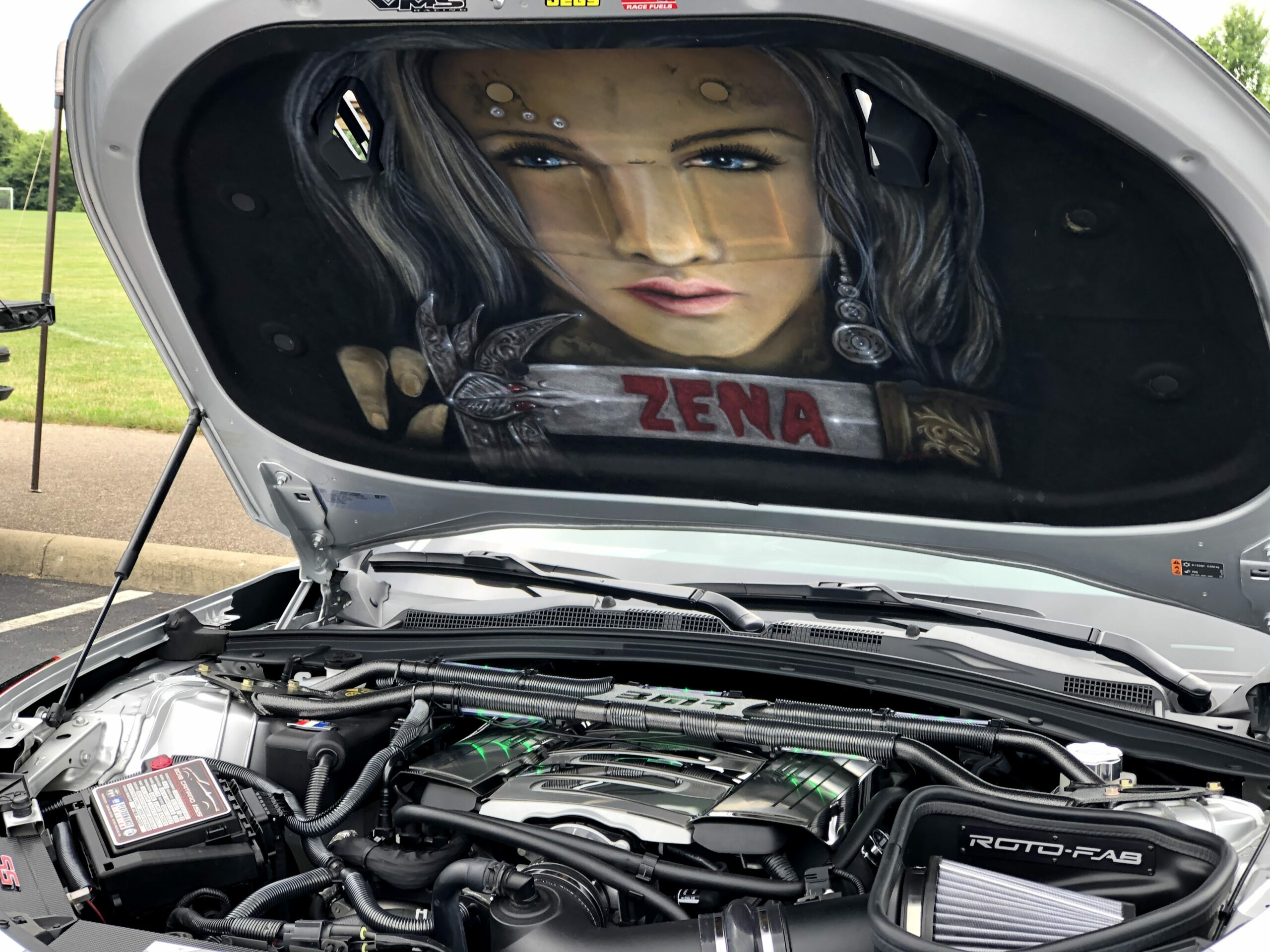 silver sports car hood up
