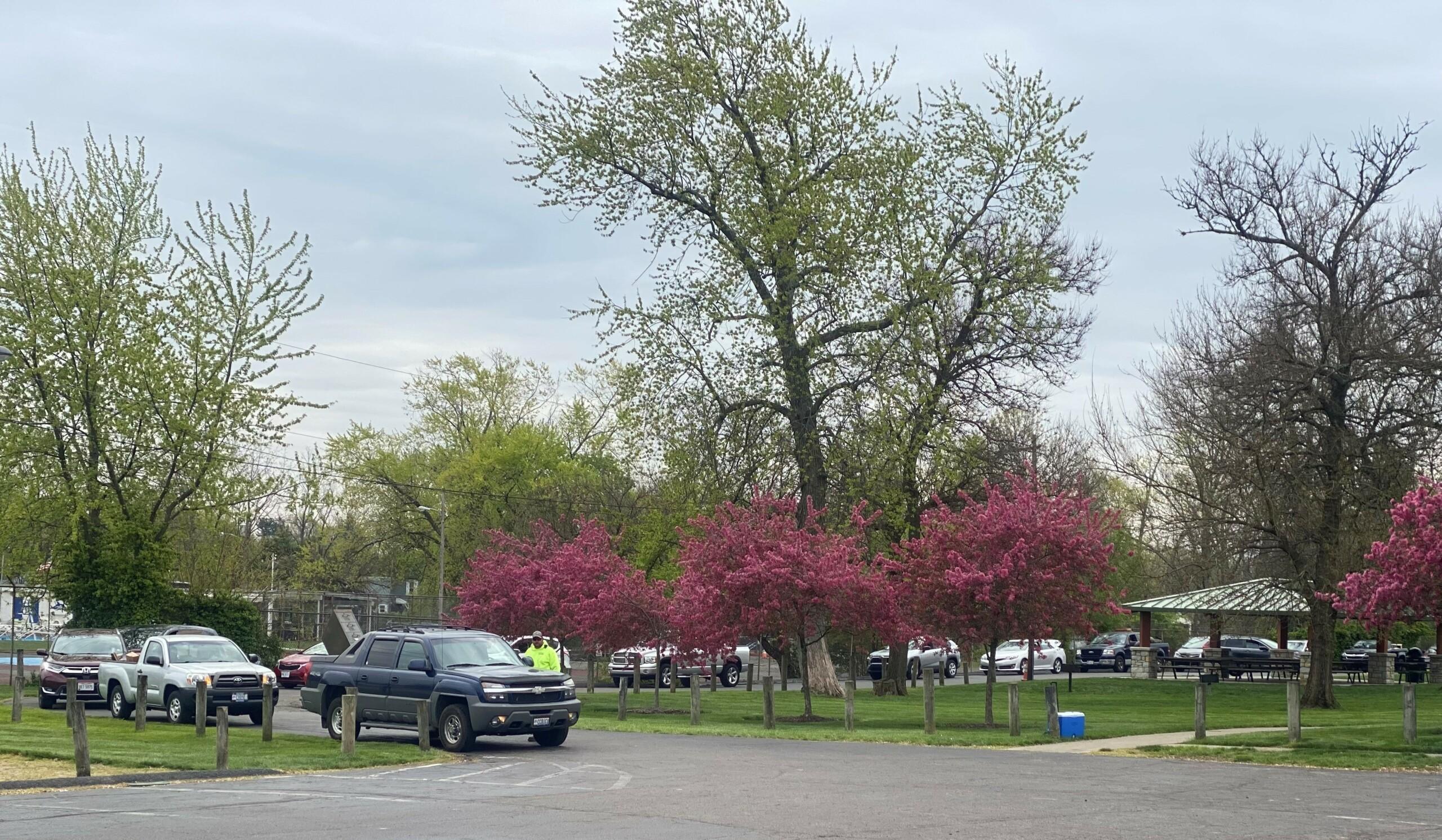 Line of cars entering Bechtold Park for Trash Bash